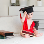 baby wearing a graduation cap